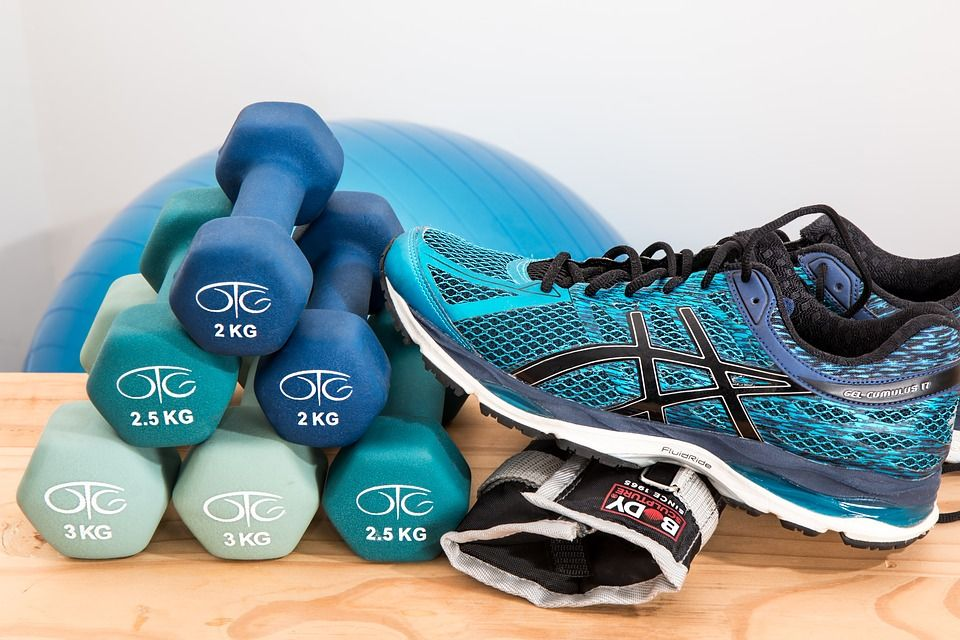 Image of workout shoes and lifting weights.